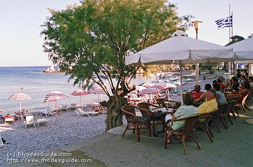 Haraki (Charaki), Rhodes, Greece. Relaxing while having a drink on one of the many cafeterias and restaurants on the beach road